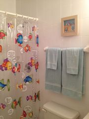 Luquillo condo photo - The Immaculate Second Bathroom With Beach Theme.