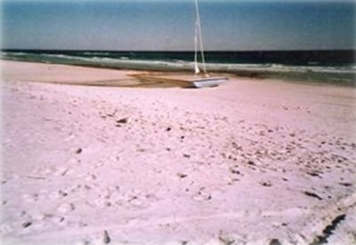 Sand, surf and a sail boat on beautiful Seagrove Beach - just out your door.