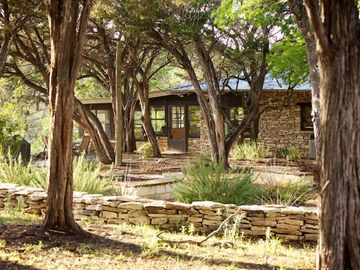 Wimberley house rental - Casa Grande with patio, fire pit and Bocce ball overlooking the Blanco River.