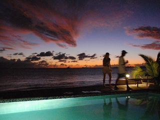 Simpson Bay condo photo - Sunset at pool