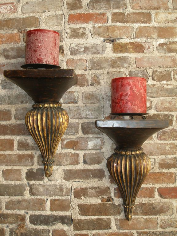 Brackets and candles on original 1800's brick wall