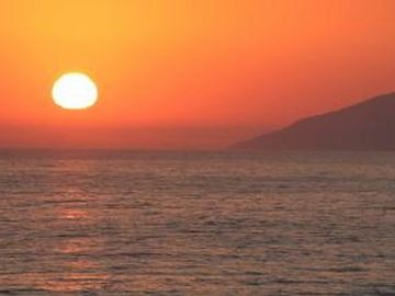 Pismo Beach condo rental - View of sunset from the private patios of this 2-story condo on the sand