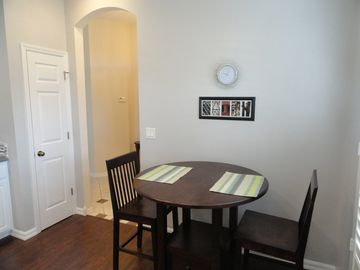 Breakfast nook in kitchen. Pantry closet on the left stocked with lots of items.