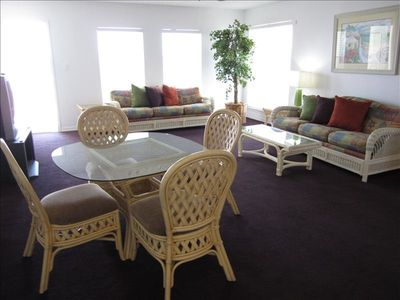 Spacious living/dining room with a balcony overlooking the beach!