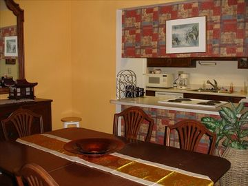 Dining Room w/Antique Dining Set, Hardwood Floors, Kitchen Bar.