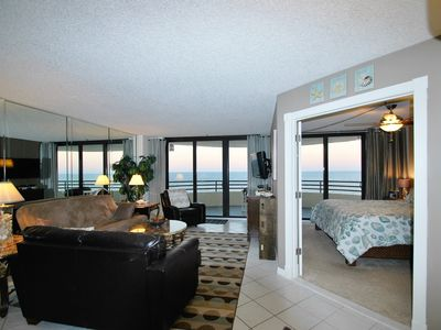 view from Dinning area of sunset,  only renting unit with French doors in MB