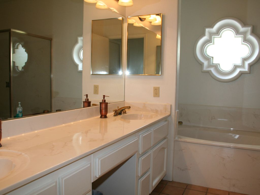 master bath double sinks, large soaking tub and large walk in shower priv toilet