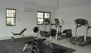 Nassau & Paradise Island townhome photo - Air conditioned communal gym with two treadmills, TV, eliptical and weights.