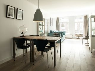 South Amsterdam apartment photo - { Dining space with view to sitting area, windows street side }