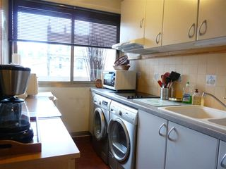 8th Arrondissement Champs Elysees apartment photo - New full sized washer & dryer. Half-size fridge, micro, stove, toaster, etc.