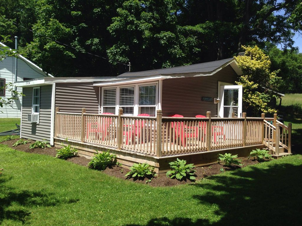 Cozy lakefront home on lamoka with dock vrbo for Deck around house
