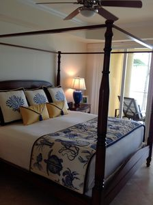 Master bedroom with king size bed overlooking beach