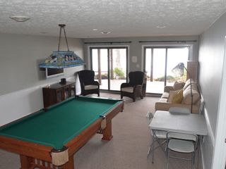 Huddleston house photo - lower level game/tv room with lake view and deck