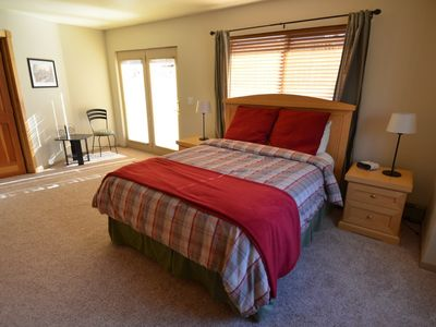 Old Town townhome rental - Bedroom with queen size bed and door to outdoor deck