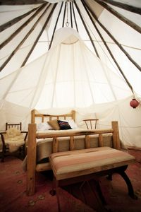 Teepee interior with queen bed