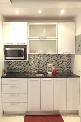 Isla Verde apartment photo - Lots of cabinets to accommodate cookware, coffee maker, blender, rice maker, etc