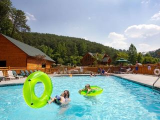 Pigeon Forge cabin photo - Seasonal outdoor swimming pool. Indoor pool on left