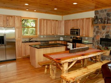 The fully stocked gourmet kitchen with service for 12 and a cozy fireplace.