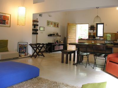 North Goa cottage rental - Living space facing dining table and rear garden