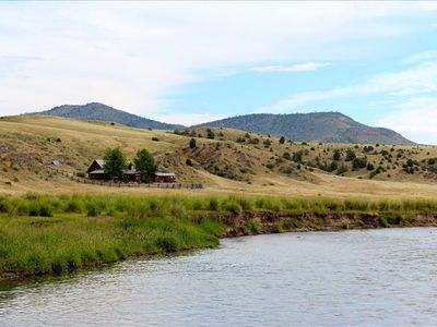 Bozeman cabin rental - A log cabin tucked into the hillside along the banks of the East Gallatin River.