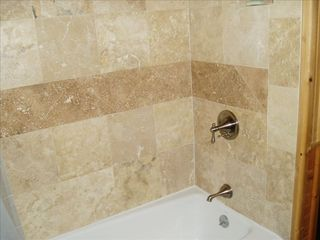 Whitefish cabin photo - Beautiful durango travertine upstairs shower