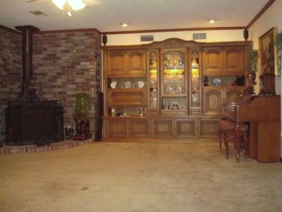 Spacious living room, buck stove, wall unit, piano