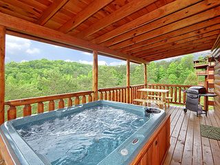 Pigeon Forge cabin photo - Hot tub on open deck with wooded views gas grill and picnic table