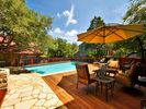 Large backyard area with pool, grill, dining and lounging area.