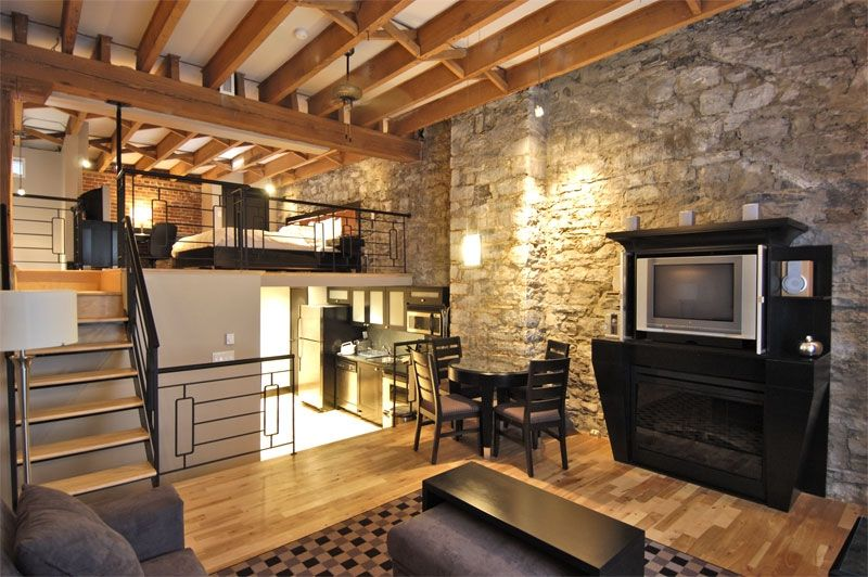 Stone deluxe loft charming old montreal 1 br vacation for Table exterieur luxe