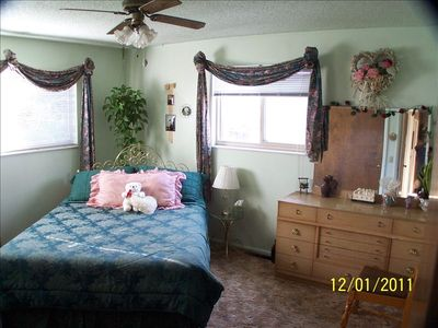 Master Bedroom with 1/2 bath washer & dryer, extra supplies