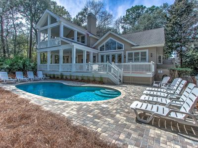 Back view of porches, hot tub deck and sunny pool area