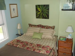 Floral bouquet on Queen size bed - Buttermilk Bay cottage vacation rental photo