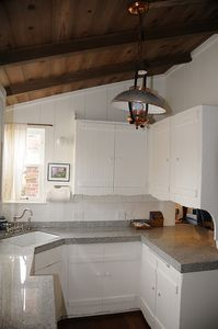 fully stocked kitchen with granite counters, dish washer, stove and microwave