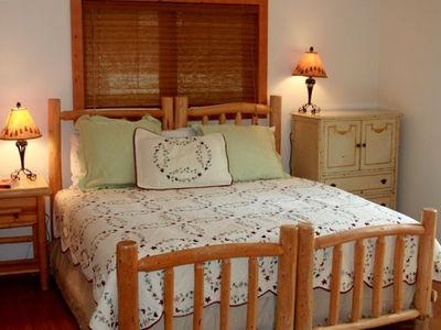 A second Master Bedroom set up with a king size bed upstairs