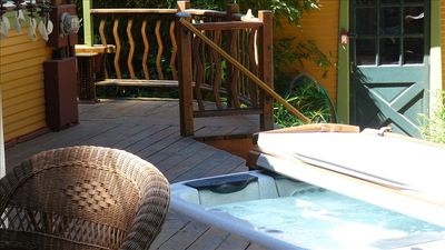 Private ozonated spa and recycled redwood deck for complete relaxation.