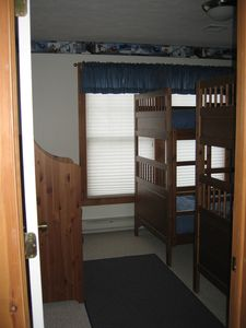"""The Kids Room"", complete with 2 bunk beds, television, & closet"