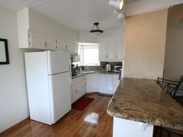 Granet counter tops with wonderful kitchen amenities.