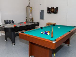 Indian Creek villa photo - Game room equipped with air hockey, pool table, dart board, stereo and books.