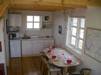South Iceland house rental - Nordurnes: Dining with view onto vulkano Hekla