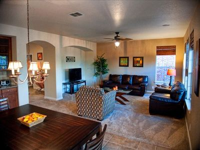 comfortable open concept living and dinning room that opens to private back yard