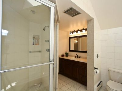 Master bath has both glass shower and jacuzzi.