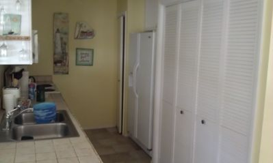 Kitchen with LARGE capacity washer and dryer behind the doors. Easy access.