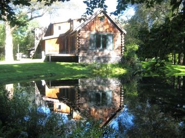 Andes house rental - Walk in the gardens or swim in the pond off the living room