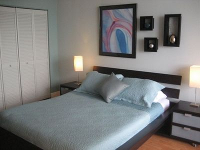 Guest room with queen bed and ample closets