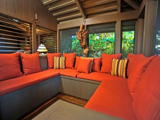 Kaanapali cottage photo - Screened Lanai with built-in furniture invites the tropical environment inside.