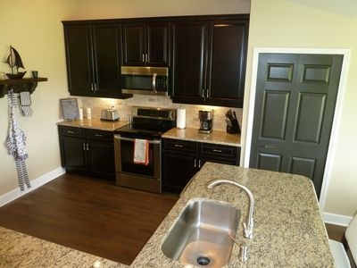 Beautifully appointed new kitchen, granite countertops, soft touch draws