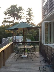 Back deck which overlooks yard is perfect for outdoor dining