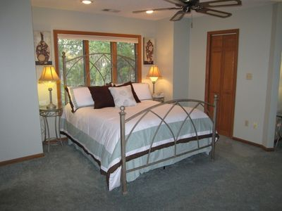 Sink into this queen bed with luxury linens in the spacious master bedroom