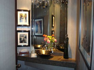Indian Wells estate photo - bronze powder sink on granite