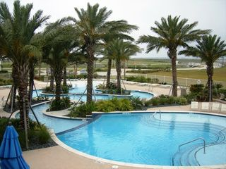 Galveston house photo - Sunset pool and lazy river pool on the bay side of the resort.